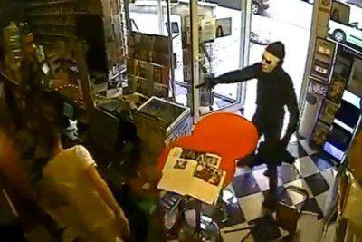 Robber-with-gun-is-no-match-for-ciggie-shop-dog