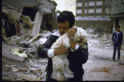 image of man hugging his dog after his 2 children died in earthquake. (Photo by Charles Bonnay/The LIFE Images Collection/Getty Images)