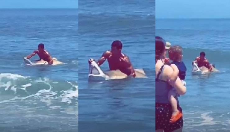 ragazzo blocca lo squalo a mani nude